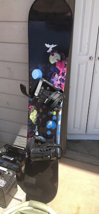 black and blue snowboard with bindings 1895 mi