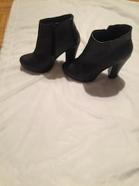 pair of women's black leather heeled booties Montréal, H4R 1W2