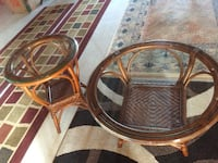 two round brown wooden frame glass top side tables Hamilton