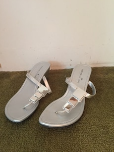 pair of gray leather t-strap wedge sanadls