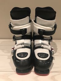 pair of white-and-black ski boots