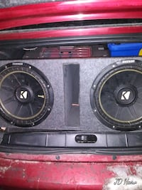 "Two 12"" Kicker Comp C's in ported box with 3 fared power cap on back"
