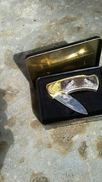 gray and brown pocket knife with case