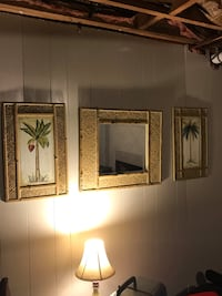 two brown wooden framed wall decors