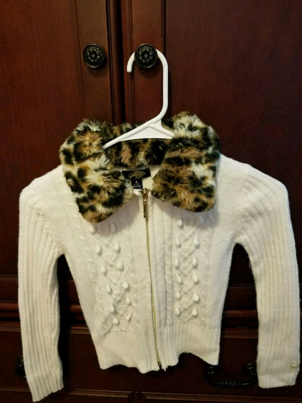white and black floral long-sleeved shirt