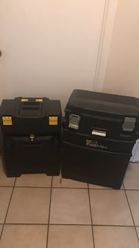 two black tool boxes