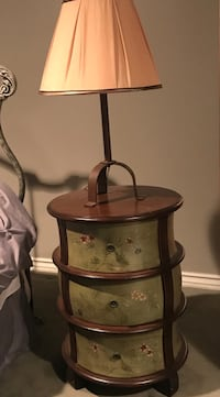 brown desk lamp and brown wooden 3-drawer chest