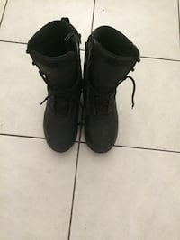 pair of black leather boots Calgary, T3J