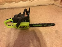 green and black Poulan chainsaw