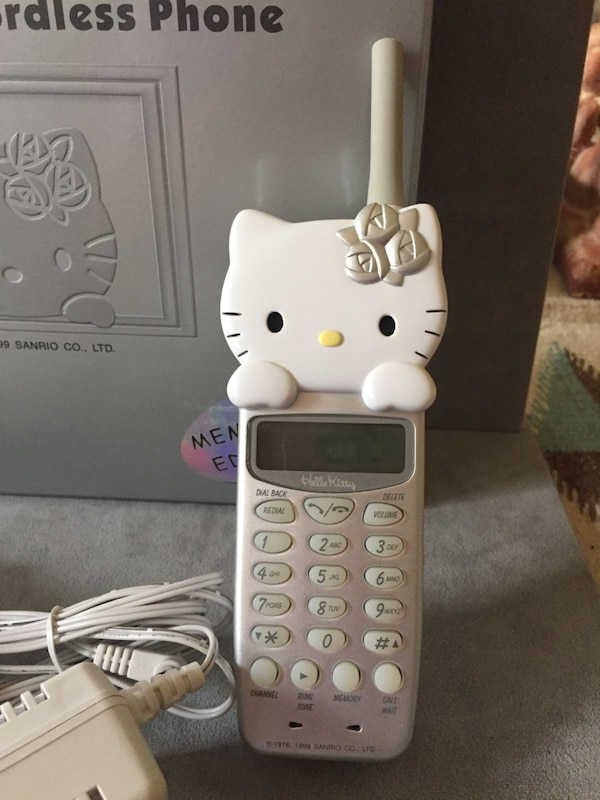 """Gray Hello Kitty wireless telephone  """"Reserved for Suzy B"""", pending pick up 3cdafb92-5461-48f5-98b0-7fe638a34a1d"""