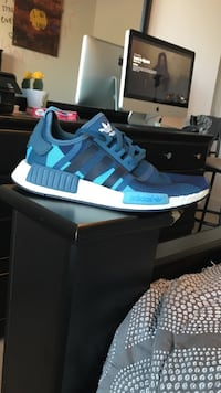 pair of blue Adidas NMD shoes with box