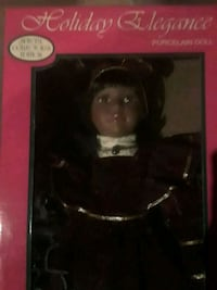 Porcelain doll new in box Flint, 48507
