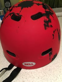 red and black Bell bicycle helmet New Lachine, H8S 3H9