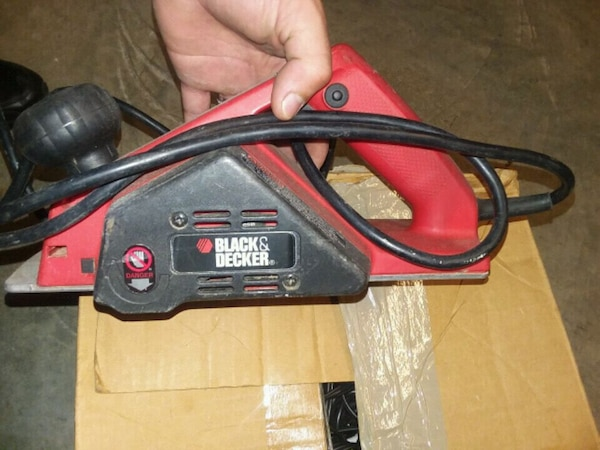 black and red corded power tool