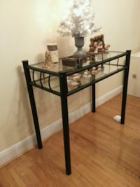 Black glass side table.  Toronto, M3K 1S9