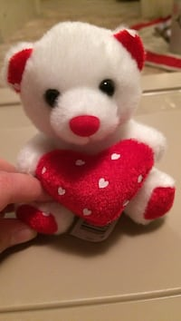 white and red bear plush toy