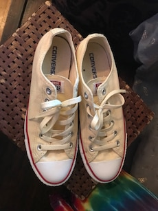 pair of white-and-red Converse low top sneakers with box