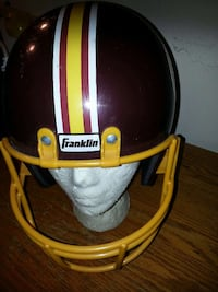 maroon, yellow, and white franklin brand football helmet District Heights, 20747