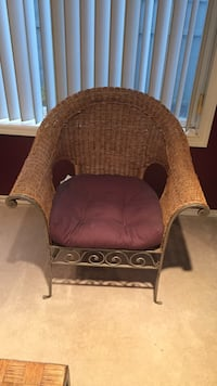 Gray and brown wicker armchair