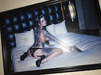 photo of woman wearing black panty holding airsoft pistol on white bed with black wooden frame Modesto, 95356