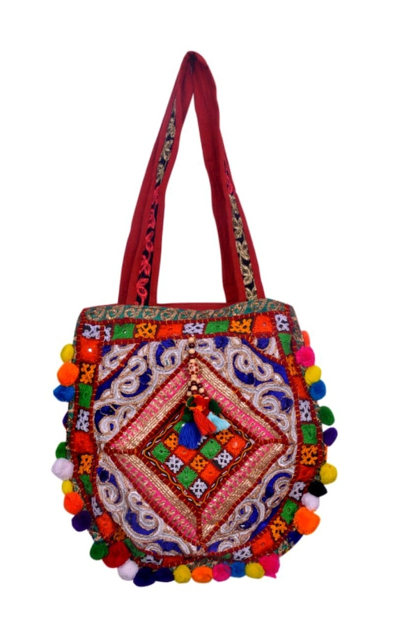 blue, yellow, and red floral crossbody bag
