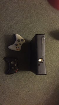Black xbox 360 with two controllers London, N6A 1A6