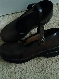 pair of black leather wedge sandals