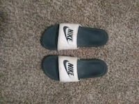 pair of black-and-white Nike slide sandals Chico, 95926