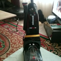 black and gray Bissell upright vacuum cleaner Surrey, V3X 1S9