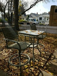 round black metal patio table with four chairs Regina, S4T 4G1