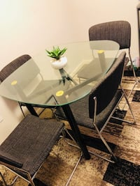 round glass top table with four chairs Calgary, T3N