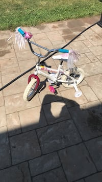 12 inch SuperCycle Pixie Dust bike with tassels, princess bell and training wheels like new Vaughan, L4H 0G6
