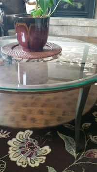 round clear glass-top table with brown wooden base Colorado Springs, 80918