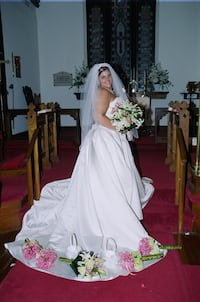 Women's white wedding dress size 16, 2 piece made special from Mary's Bridal in Annapolis. Long train with 16 different colored ribbons for the bustle. Top is all beaded and scalloped, with corset back. One of a kind! Gambrills, 21054