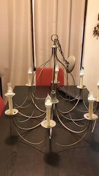 gray and white uplight chandelier