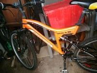 red and black full suspension mountain bike Richmond Hill, L4C 4S8