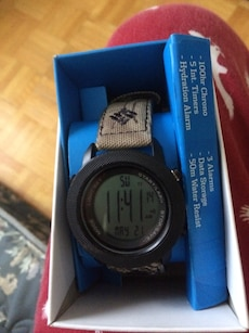 round black digital watch in box