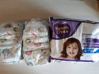 8 pairs of Huggies Diapers  size 6