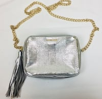 Silver purse with tassel  gold chain and gold zipper brand new, never been used. Salt Lake City, 84103