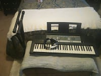 black, white, and gray electronic keyboard