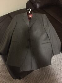 Never been worn suit 36 regular comes with a shirt and a tie  Ottawa, K2K 0C9