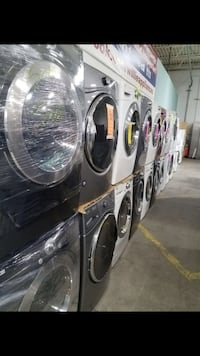 Black and gray front-load washer and dryer lot New York