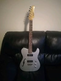 white and black electric guitar Edmonton, T5H 1H2