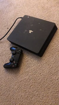 black Sony PS4 console with controller Columbia, 21044