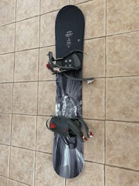 Black and gray snowboard with bindings Laval, H7E 5N7