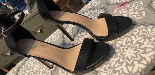 pair of black leather open toe ankle strap heels 0005ba70-9338-4465-8511-c839da83a69c
