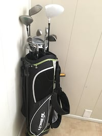 Black and white TiTech golf bag with various golf clubs