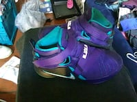 pair of purple-and-teal Nike basketball shoes