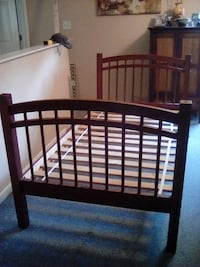 Brown wooden bed frame Pittsboro