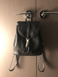 COACH leather backpack $100 Richmond, V6X 1K4